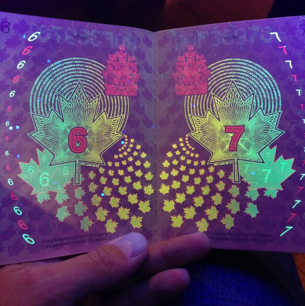 old Canadian passport under a blacklight